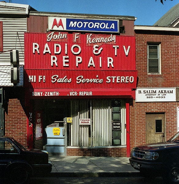 tv repair shop. the proprietor, whose name truly is john f. kennedy, opened his shop in tv repair