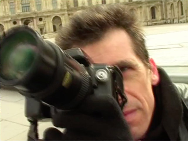 David Henry taking pictures of the Grande Pyramide du Louvre.