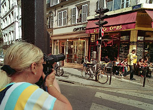 A photography student taking pictures in Paris.