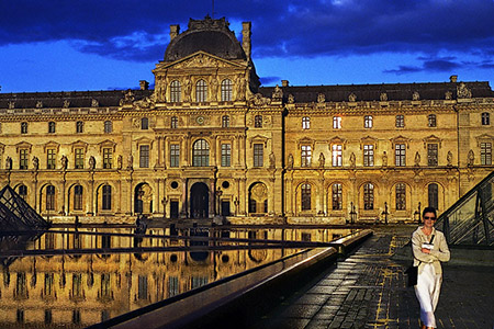 The courtyard of the Louvre Museum at sunset.
