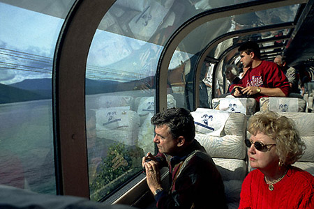 "Passengers admiring the Alberta scenery from the Rocky Mountaineer's ""dome car""."