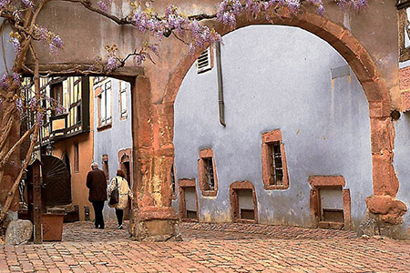 An archway leading off from Riquewihr's main street in Alsace-Lorraine.
