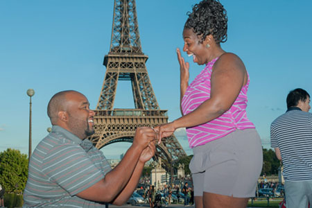 Adrian asking his girlfriend Chelsea's hand in marriage in front of the Eiffel Tower.